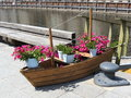 Flowers boat wooden with near river Stock Photos