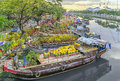 Flowers boats at flower market on along canal wharf Royalty Free Stock Photo