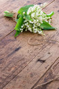 Flowers on brown wooden backgrond bouquet of spring lilys of the valley Stock Photo