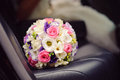 Flowers on car seat wedding bouquet leather Royalty Free Stock Photos