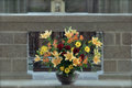 Flowers in a church bunch of colourful the vase front of granite altar Stock Photo