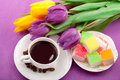 Flowers, coffee and sweets. Stock Photos