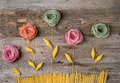 Flowers composition made of colorful pasta, topview Royalty Free Stock Photo