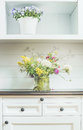 Flowers decoration on white dresser light floral home decoration and interior Royalty Free Stock Photo