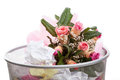 Flowers in dustbin a pink bouquet of a Royalty Free Stock Photography