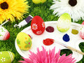 Flowers and Easter eggs on palette Royalty Free Stock Photo