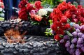 Flowers at the eternal flame in commemoration of soviet soldiers who fought with nazi invaders during second world war odessa Stock Photography