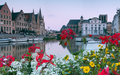 Flowers at gent look over a waterway in ghent belgium during sunset Royalty Free Stock Photography