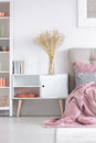 Cozy bedroom with white cupboard Royalty Free Stock Photo