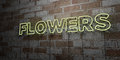 FLOWERS - Glowing Neon Sign on stonework wall - 3D rendered royalty free stock illustration