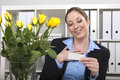 Flowers from her lover secretary received a buquet of yellow roses a secret who sent it to work place Stock Photo