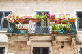 Flowers on kotor balcony flower boxes of an old stone building in montenegro Stock Photo