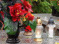 Flowers light and memory candles on the graves in the polish tradition of the symbols of on november for those who have passed Stock Image