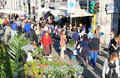 Flowers market milano people crowd look for and plants at annual flower in the characteristic design and and culture area of Royalty Free Stock Photography