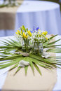 Flowers in mason jars at reception on table Royalty Free Stock Photography