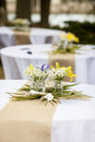 Flowers in mason jars on tables for reception Stock Photography