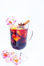 Flowers and mulled wine in glass Royalty Free Stock Photo