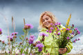 With flowers portrait of young nice woman in summer environment Royalty Free Stock Photo