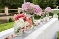 Flowers settings decoration outdoor setup for wedding with pink colored flower Royalty Free Stock Photo