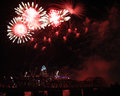 Flowers and spider fireworks over the cincinnati skyline red white flower former railway bridge spanning ohio river during Stock Photos