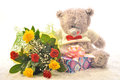 Flowers and a teddy bear with bouquet of gift Stock Photo