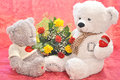 Flowers and a teddy bear with bouquet of gift Stock Images