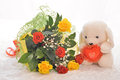 Flowers and a teddy bear with bouquet of heart Stock Photo