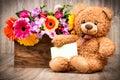 Flowers and a teddy bear