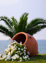 Flowers in terracotta a pot in front of the sea beach Stock Photo