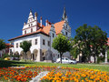 Flowers and townhall in levoca slovakia summer view of a lot of foreground unique town hall medieval city of background this Royalty Free Stock Images
