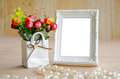 Flowers vase and blank white picture frame. Royalty Free Stock Photo