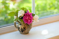 Flowers on window sill in a vase Stock Photography