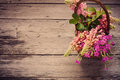 Flowers on wooden background old Stock Image