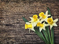 Flowers yellow daffodils on a wooden vintage background Royalty Free Stock Photo