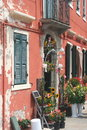At a flowershop in burano building with on an atmospheric square italy Royalty Free Stock Photo