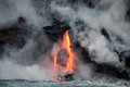 Flowing lava hot stream is into the ocean hawaii big island Stock Images