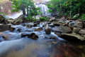 Flowing mountain stream with stones Stock Photo