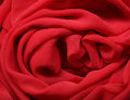 Flowing red fabric Royalty Free Stock Photo