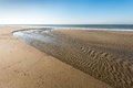 Flowing water low tide dutch north sea coast first sunny day spring Royalty Free Stock Photography