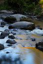 Flowing water over rocks and boulders Royalty Free Stock Photo