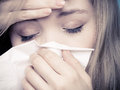 Flu fever sick girl sneezing in tissue health cold or allergy symptom closeup of young woman with care studio shot black and white Stock Images