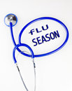 Flu season text inside a blue stethoscope on a white background Stock Image