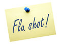Flu shot reminder written on yellow notepaper with thumb tack on white background healthcare concept Royalty Free Stock Image