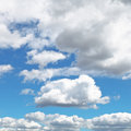 Fluffy clouds in blue afternoon sky Royalty Free Stock Photo