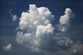 Fluffy clouds in dark sky deep blue Royalty Free Stock Images