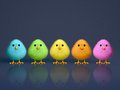 Fluffy colorful chicks dark reflective background copy space d render Stock Photography