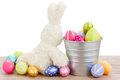 Fluffy easter bunny with eggs isolated on white background Royalty Free Stock Photography