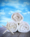Fluffy fresh towels against a blue sky Stock Photos