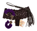 Fluffy purple handcuffs, a whip, money and panties, prostitution Stock Photos