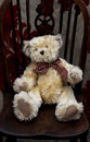Fluffy teddy bear with ribbon on the antic chair Stock Image
